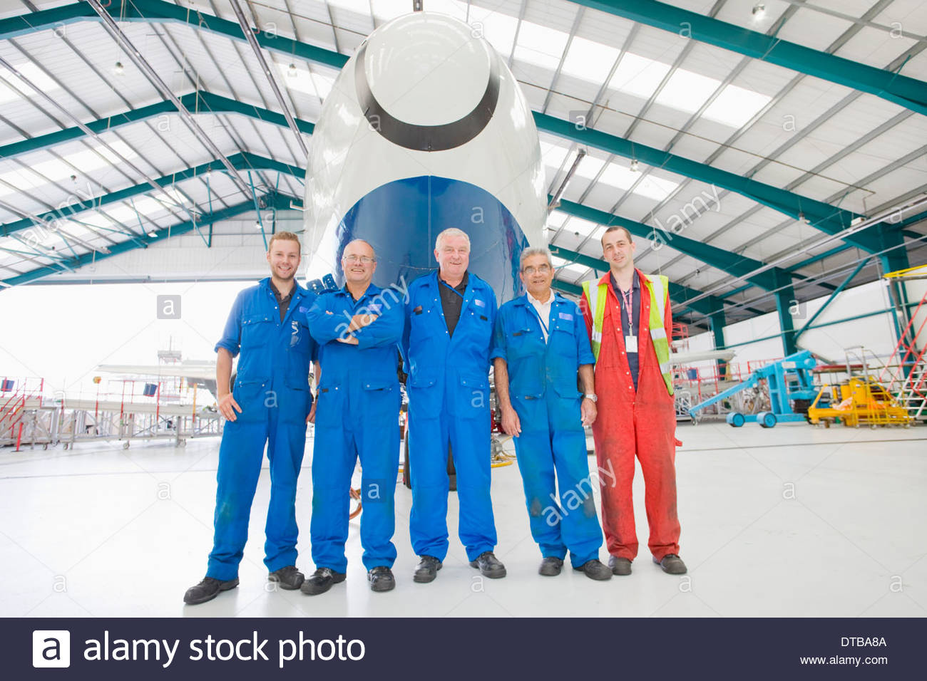 Aircraft Maintenance Team With Plane In Hangar - Stock Image