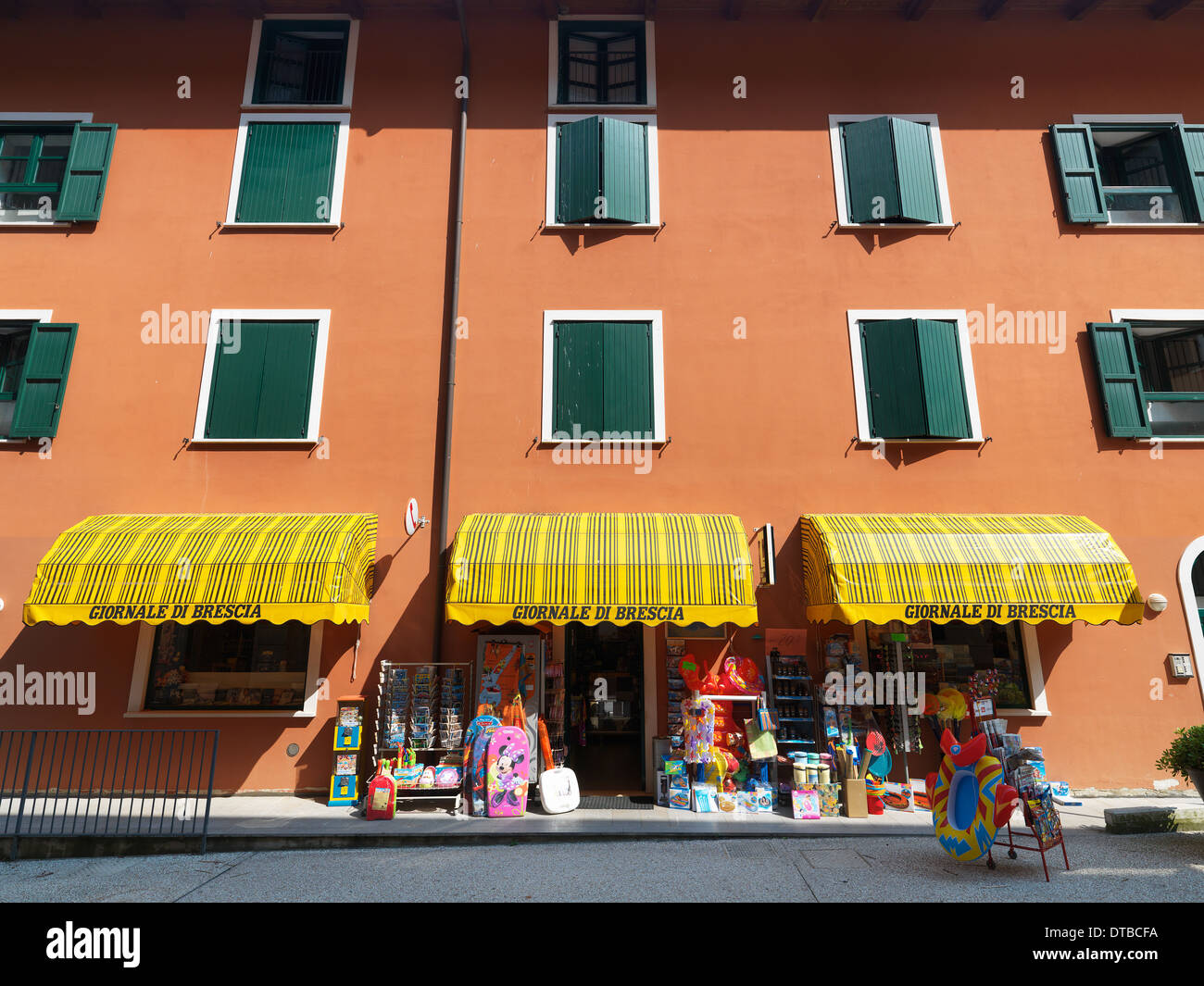 Campione del Garda , Italy, kiosk with newspapers, postcards , swimwear and beach accessories - Stock Image