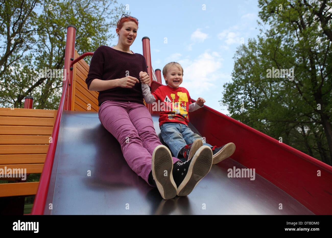 Berlin, Germany , a mother with her son on a slide Stock Photo