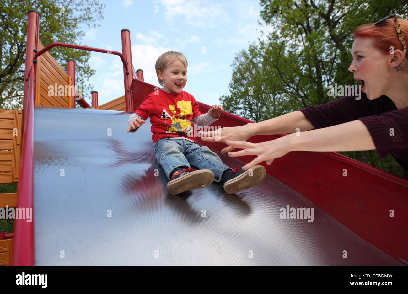 Berlin, Germany , a small child sliding down a slide Stock Photo
