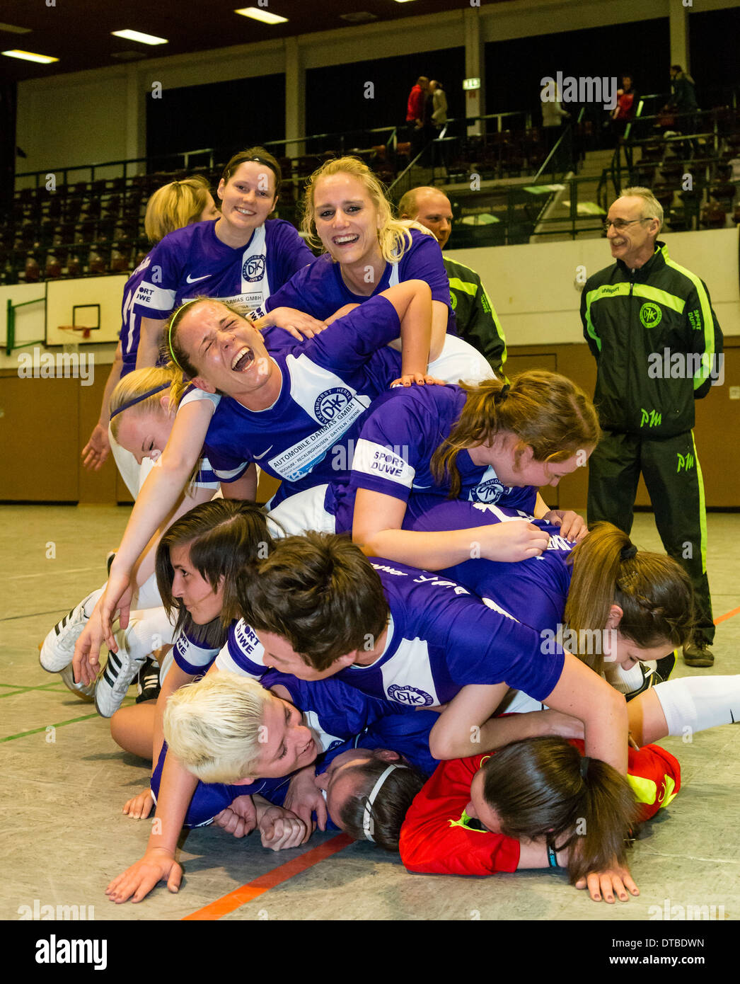 The women's football / soccer team of DJK Falkenhorst rejoice after their victory in a cup final. - Stock Image