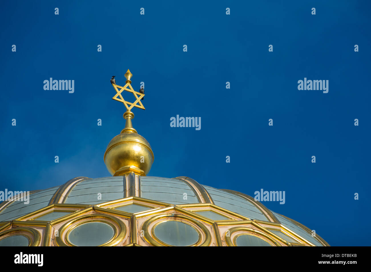 Berlin, Germany , Spire of the New Synagogue in Oranienburger Strasse with jackdaws Stock Photo