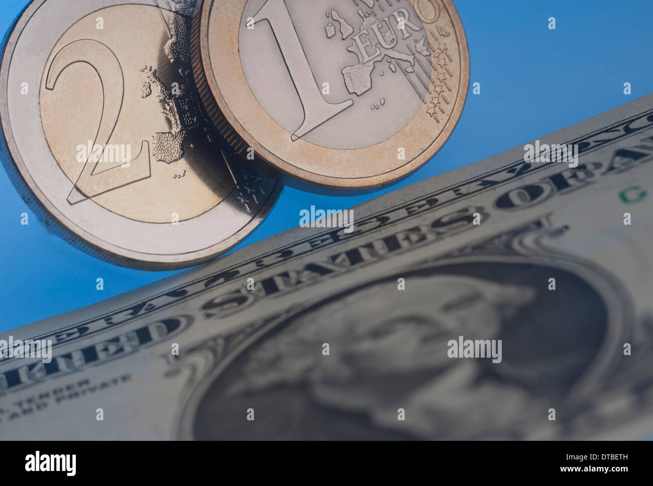 Euromuenzen and dollar bill Stock Photo