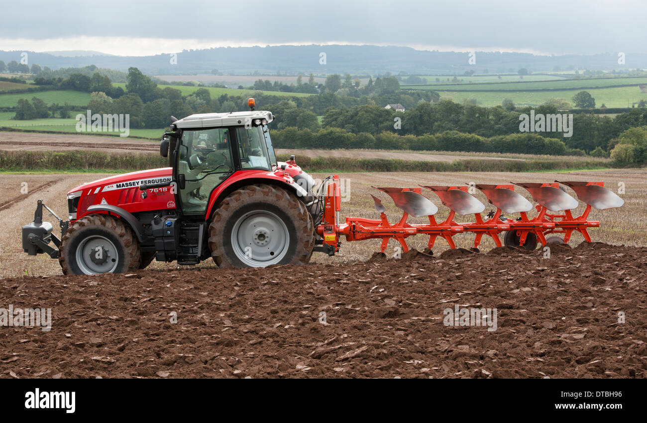 Massey Ferguson 7618 tractor and Kuhn plough at the 63rd British National Ploughing Championship in 2013. - Stock Image