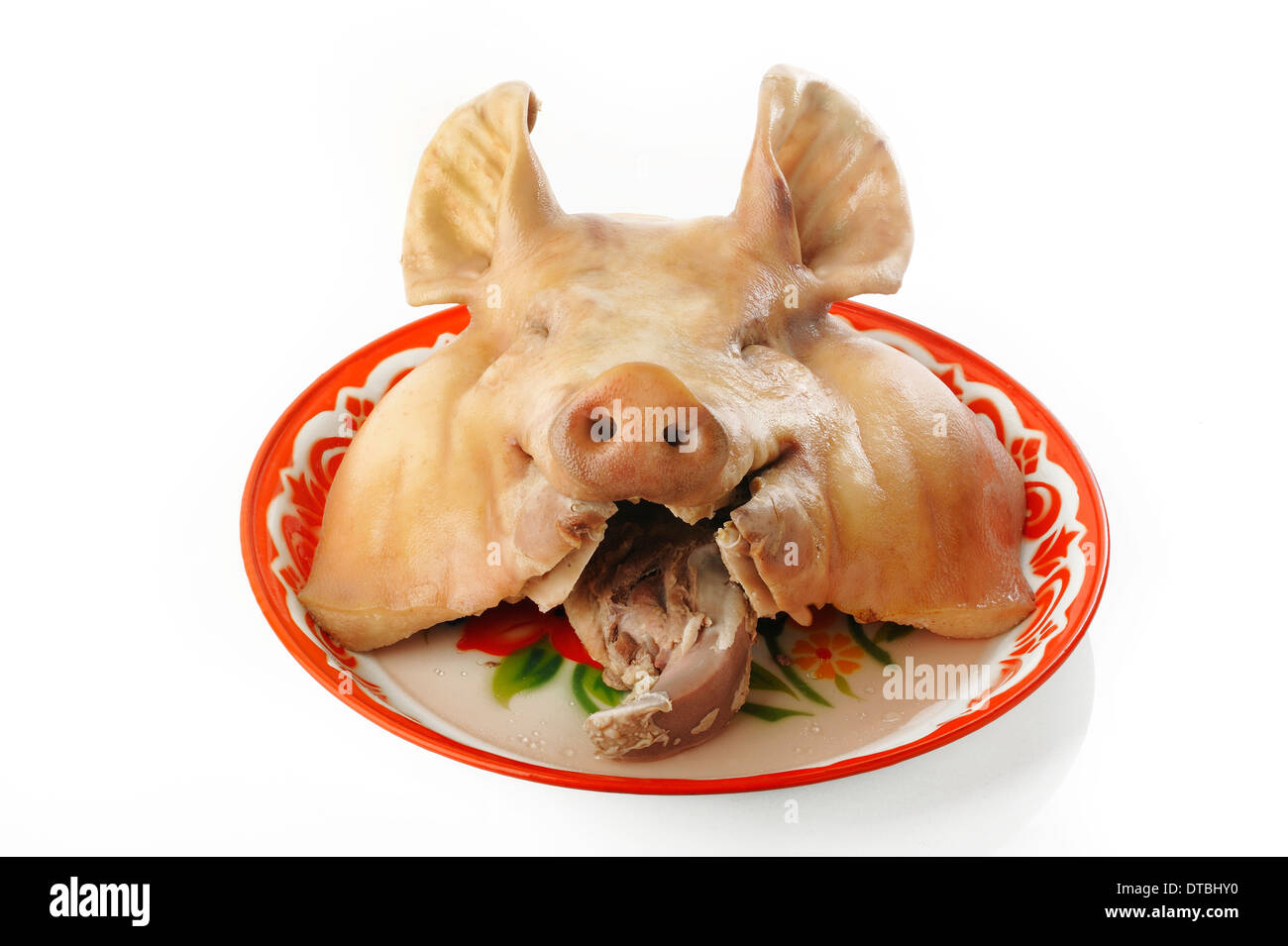 Boiled pig head on tray - Stock Image