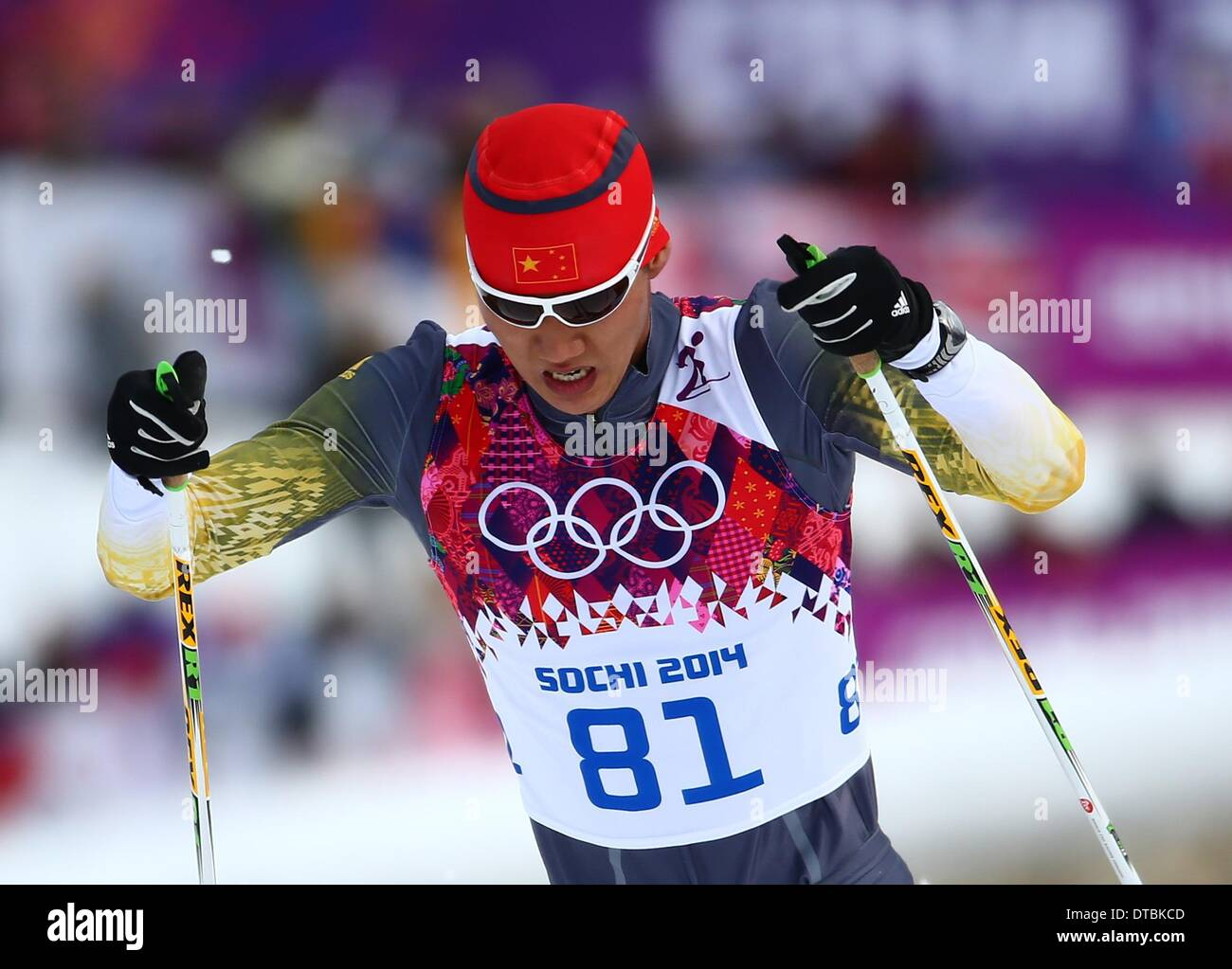 Krasnaya Polyana, Russia. 14th Feb, 2014. Sun Qinghai of Chaina competes during the Men's 15km Classic Cross Country Stock Photo