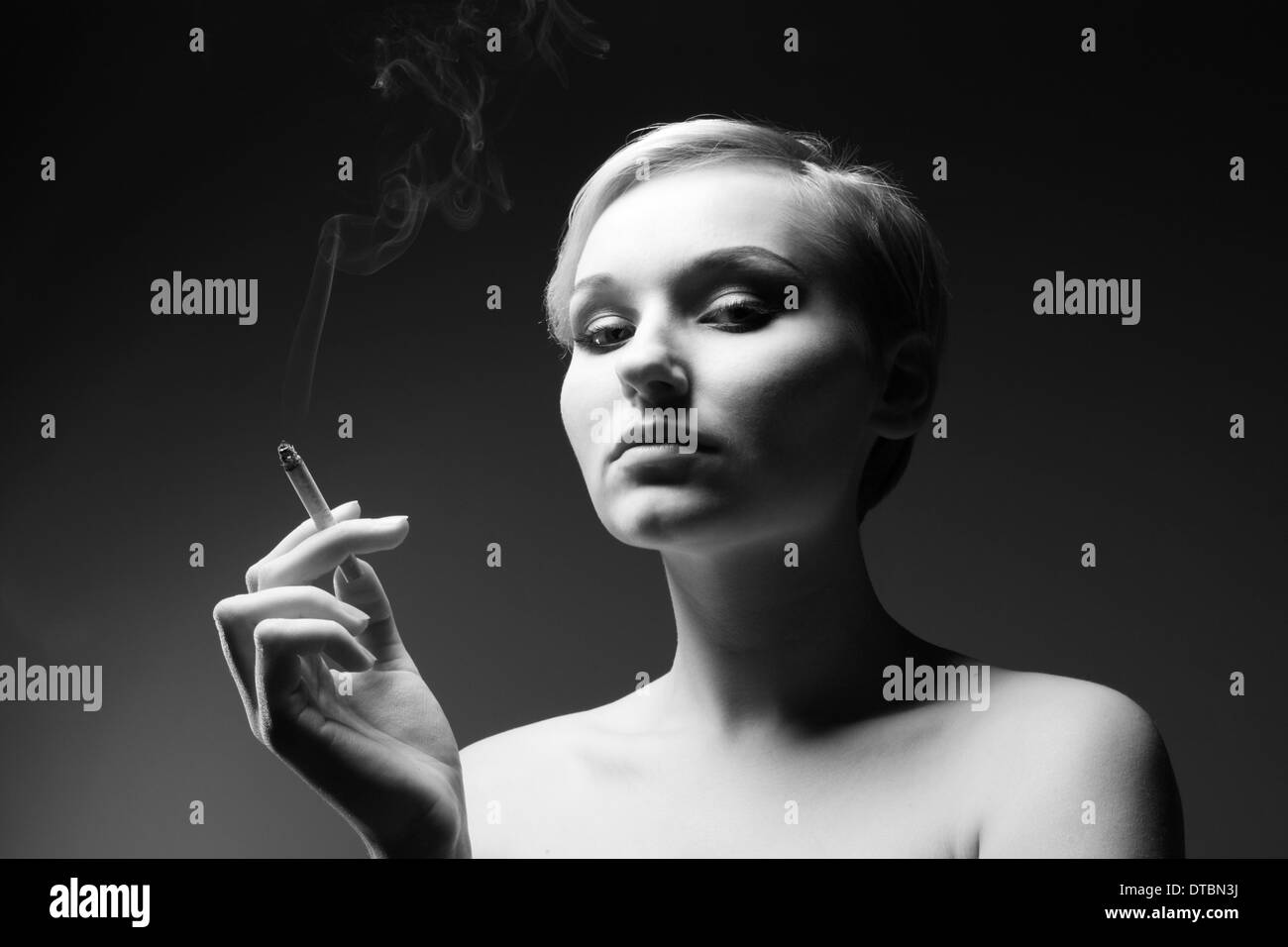 Black and white portrait of a woman with cigarette - Stock Image