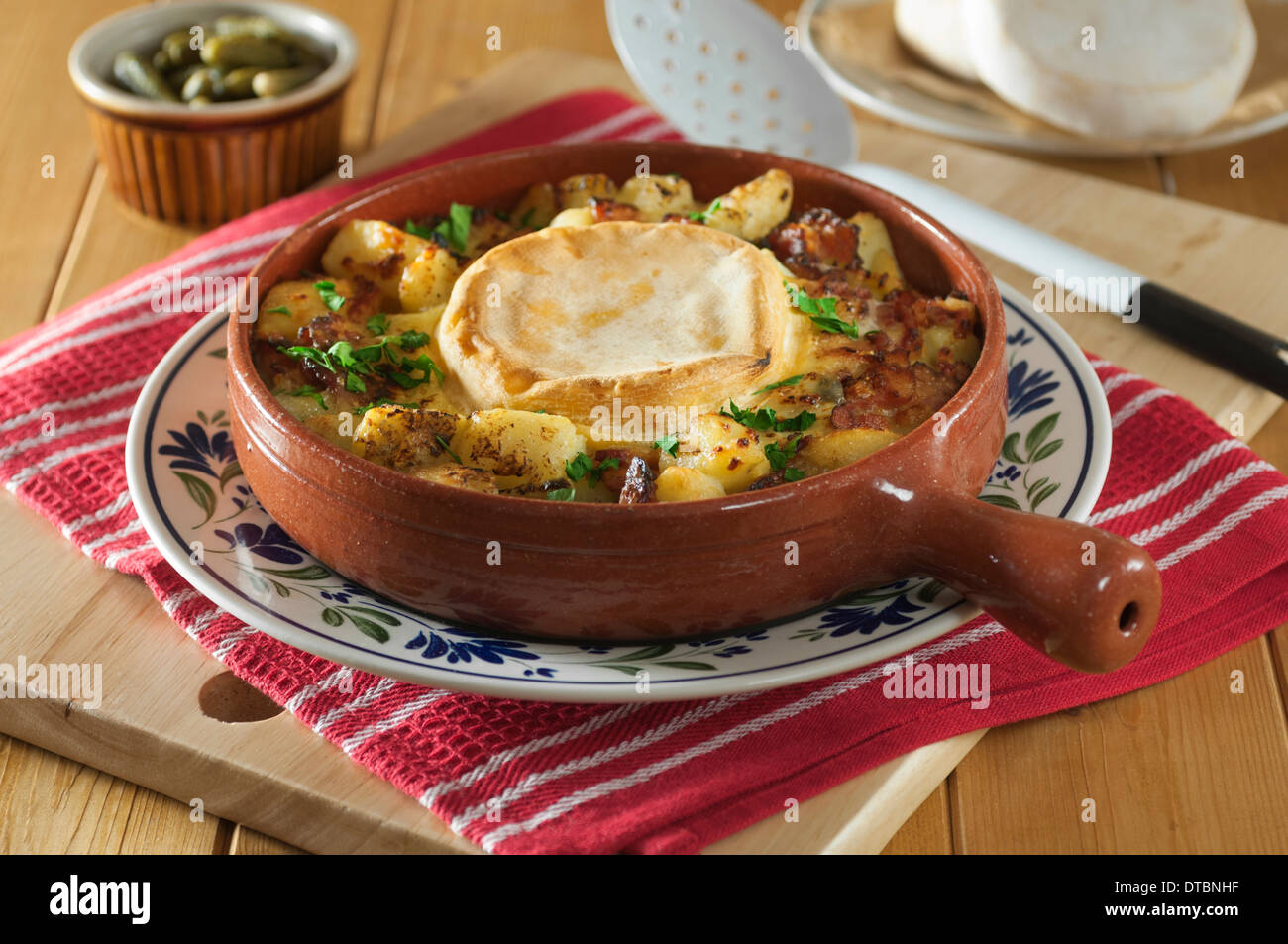 Tartiflette. Potato and bacon dish with Reblochon cheese. France Food - Stock Image