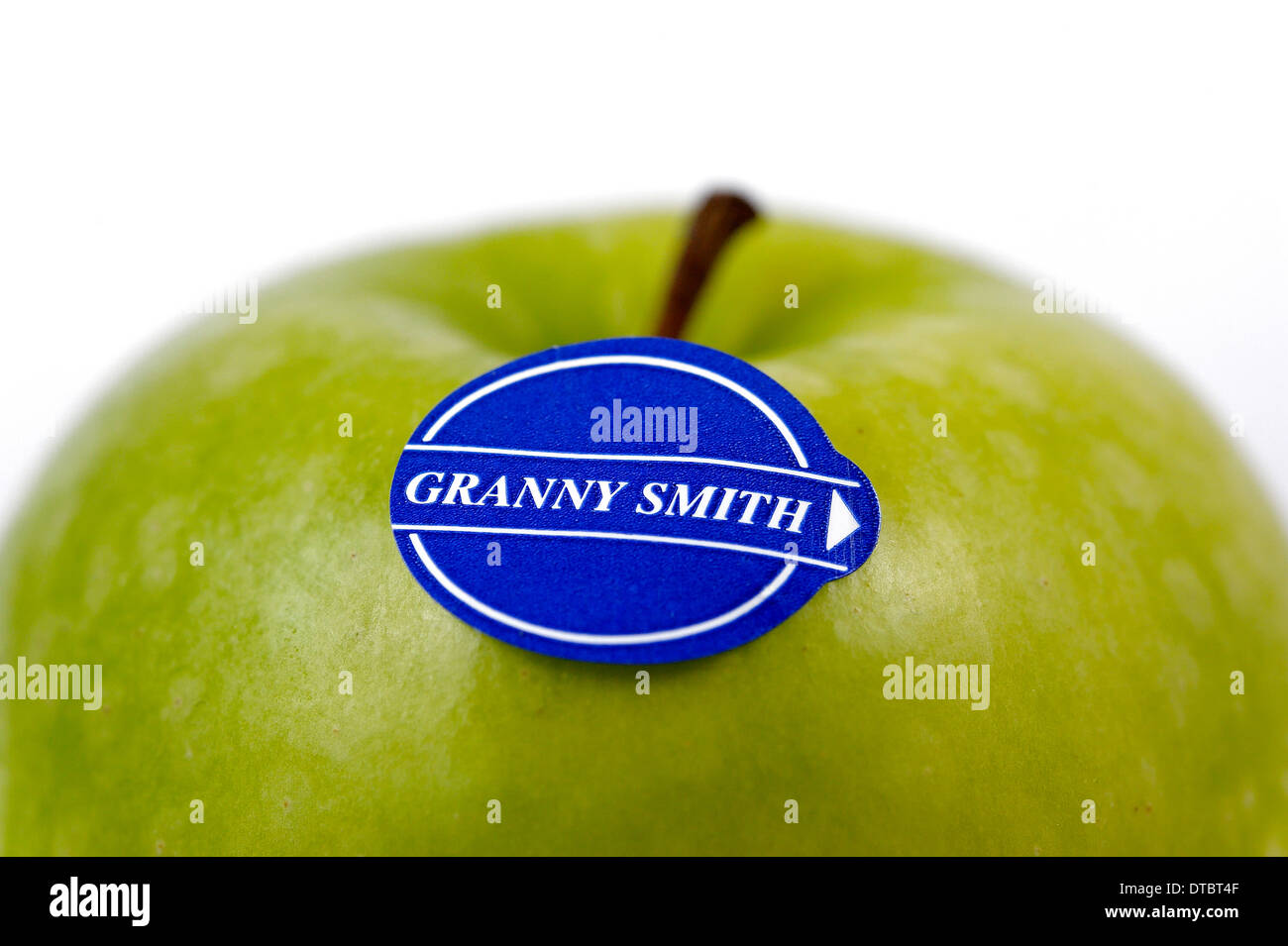 A Granny Smith apple on a white background - Stock Image