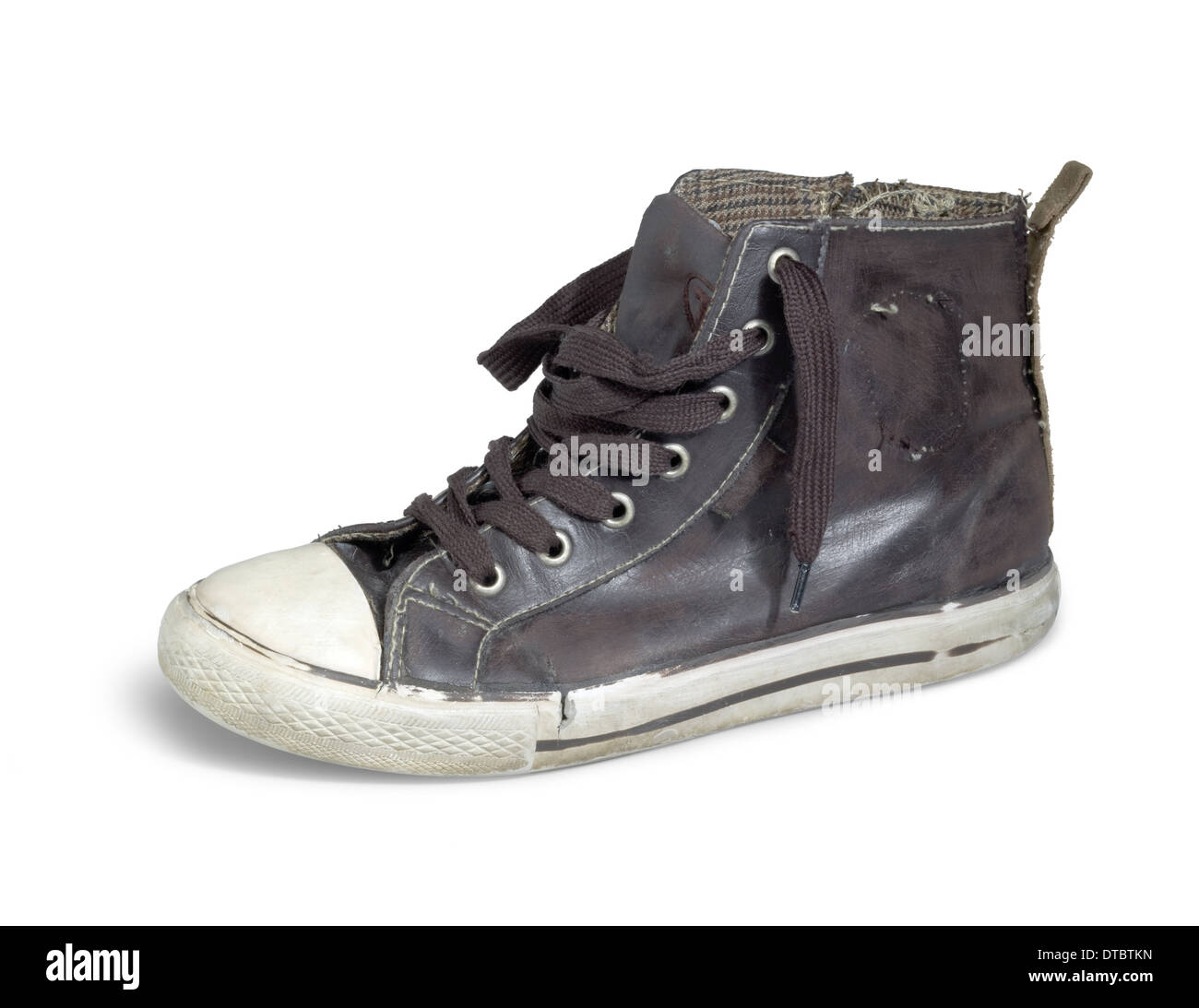 a old brown sneaker in white back Stock Photo