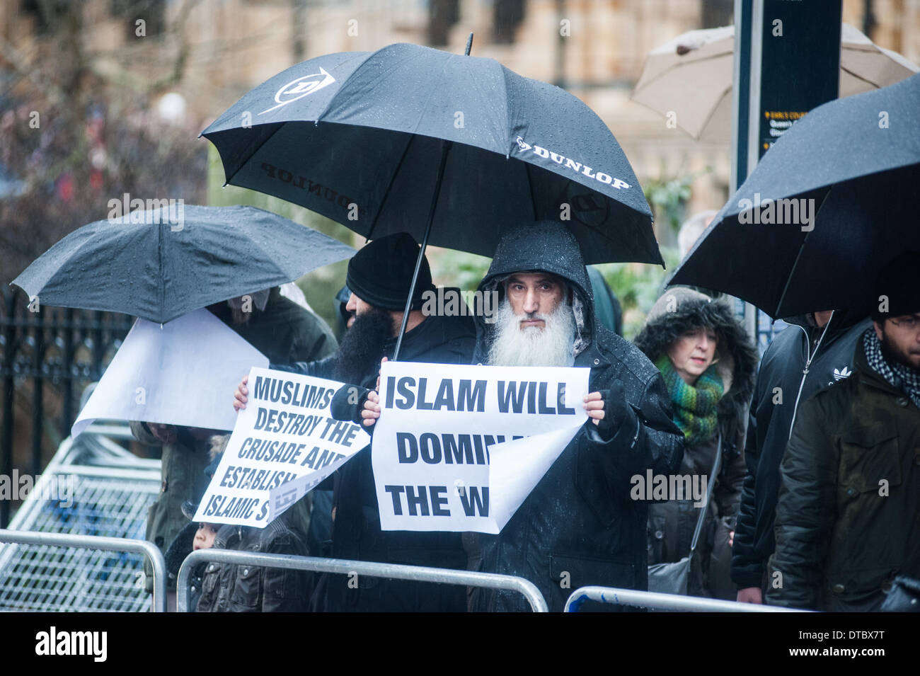 London, UK - 14 February 2014: a Muslim activist, holding a placard reading 'Islam willl dominate the World', demonstrates in Central London in support of Muslims allegedly slaughtered in the Central African Republic (CAR) by Christian vigilantes known as Anti-Balaka. Credit:  Piero Cruciatti/Alamy Live News - Stock Image