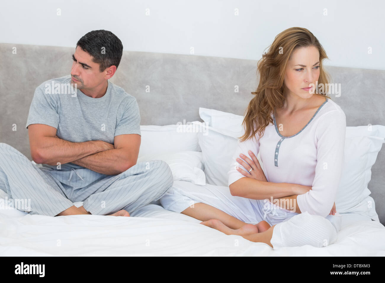 Couple ignoring each other - Stock Image