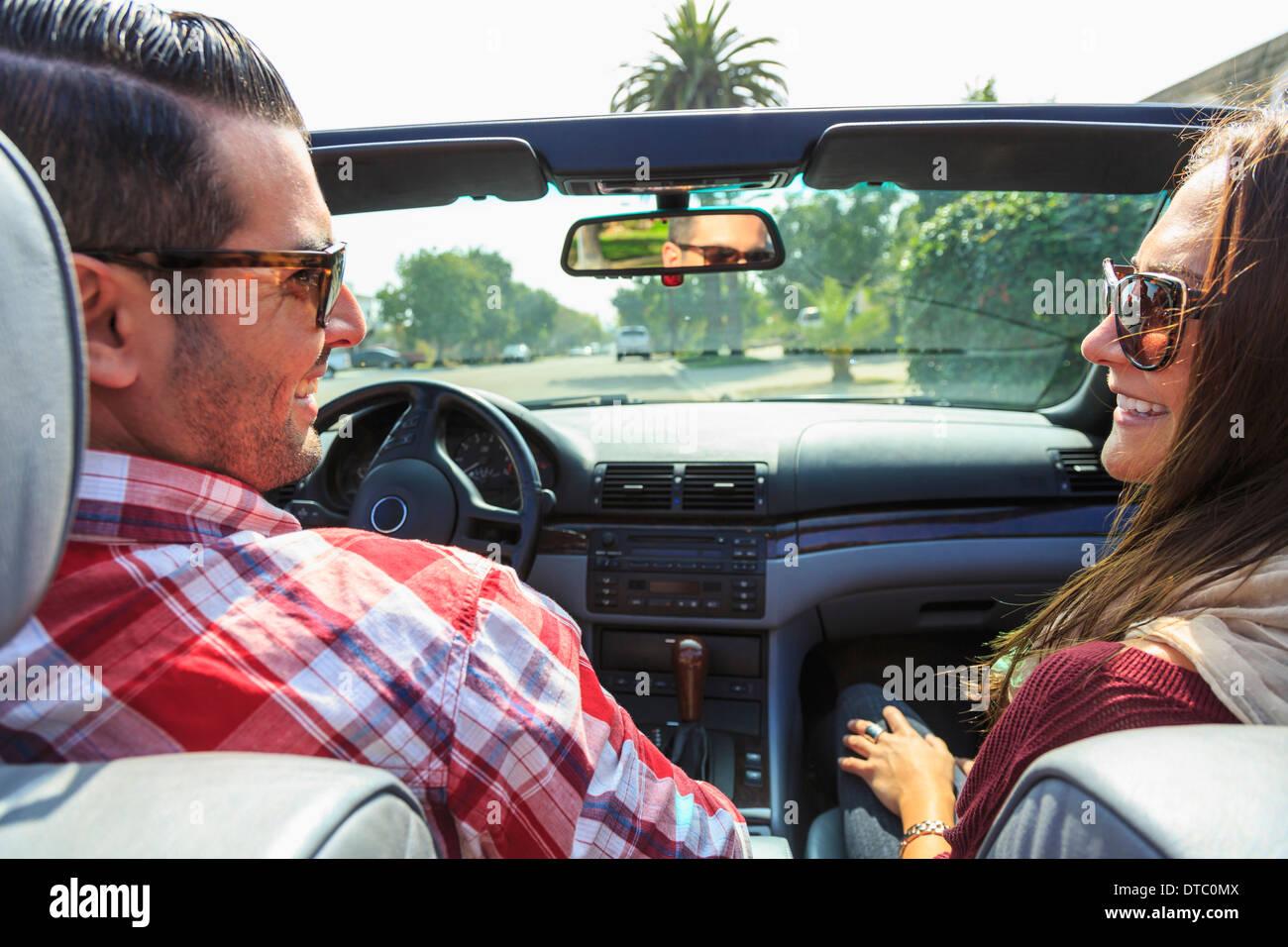 Young couple in convertible, San Diego, California, USA Stock Photo