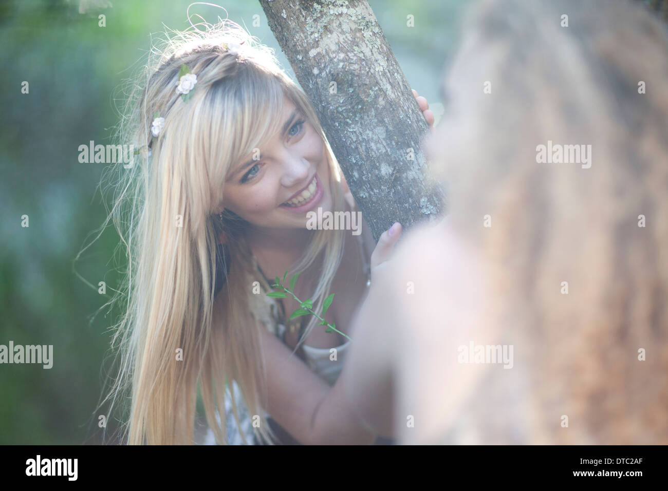 Two teenage girls exploring woodland - Stock Image