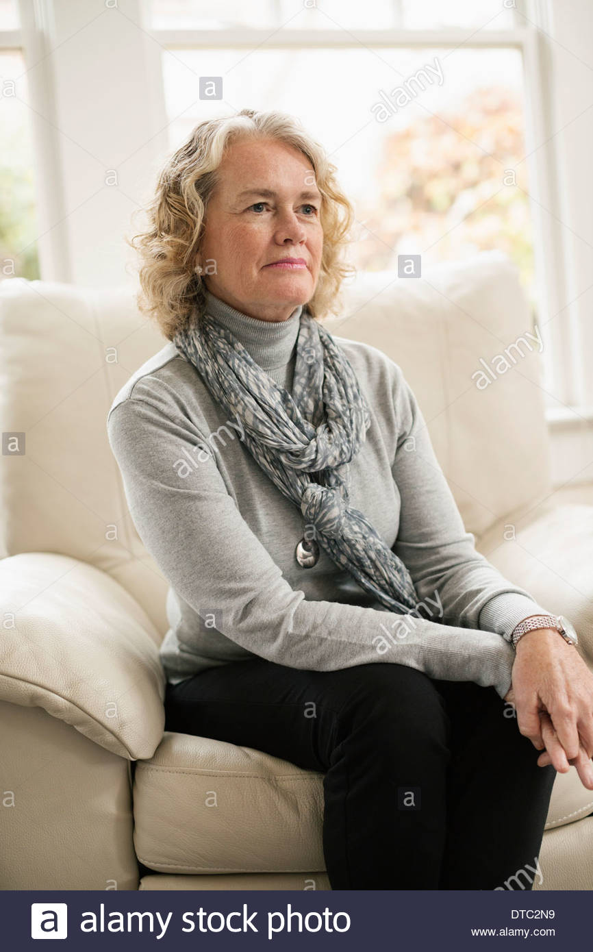 Portrait of contented senior woman at home - Stock Image