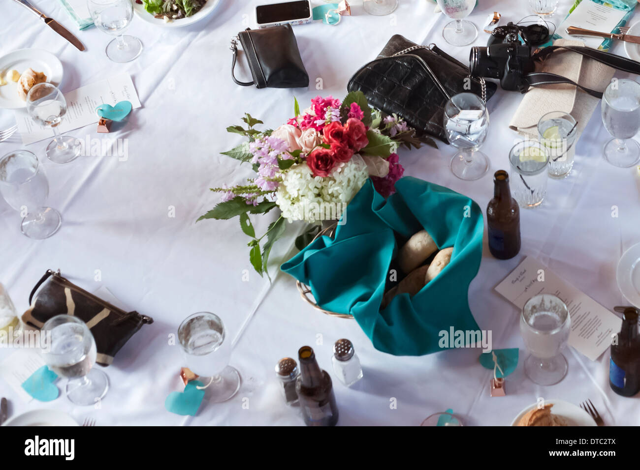 Still life of wedding reception table with drinks and purses - Stock Image