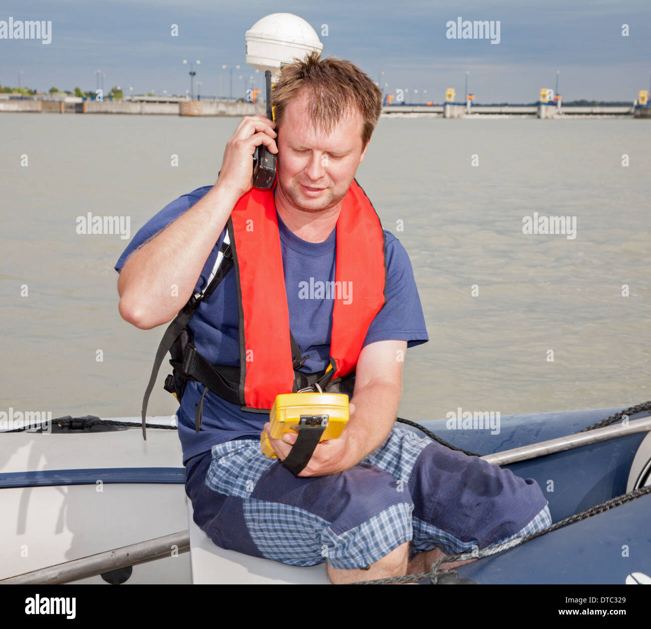 Man on the boat at measuring with the GPS on the Danube river - Stock Image