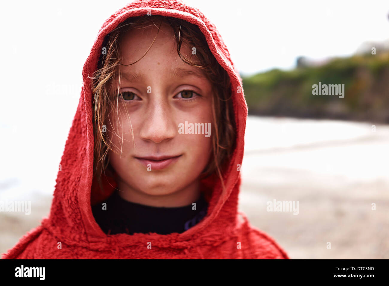 Portrait of girl in red hooded top - Stock Image