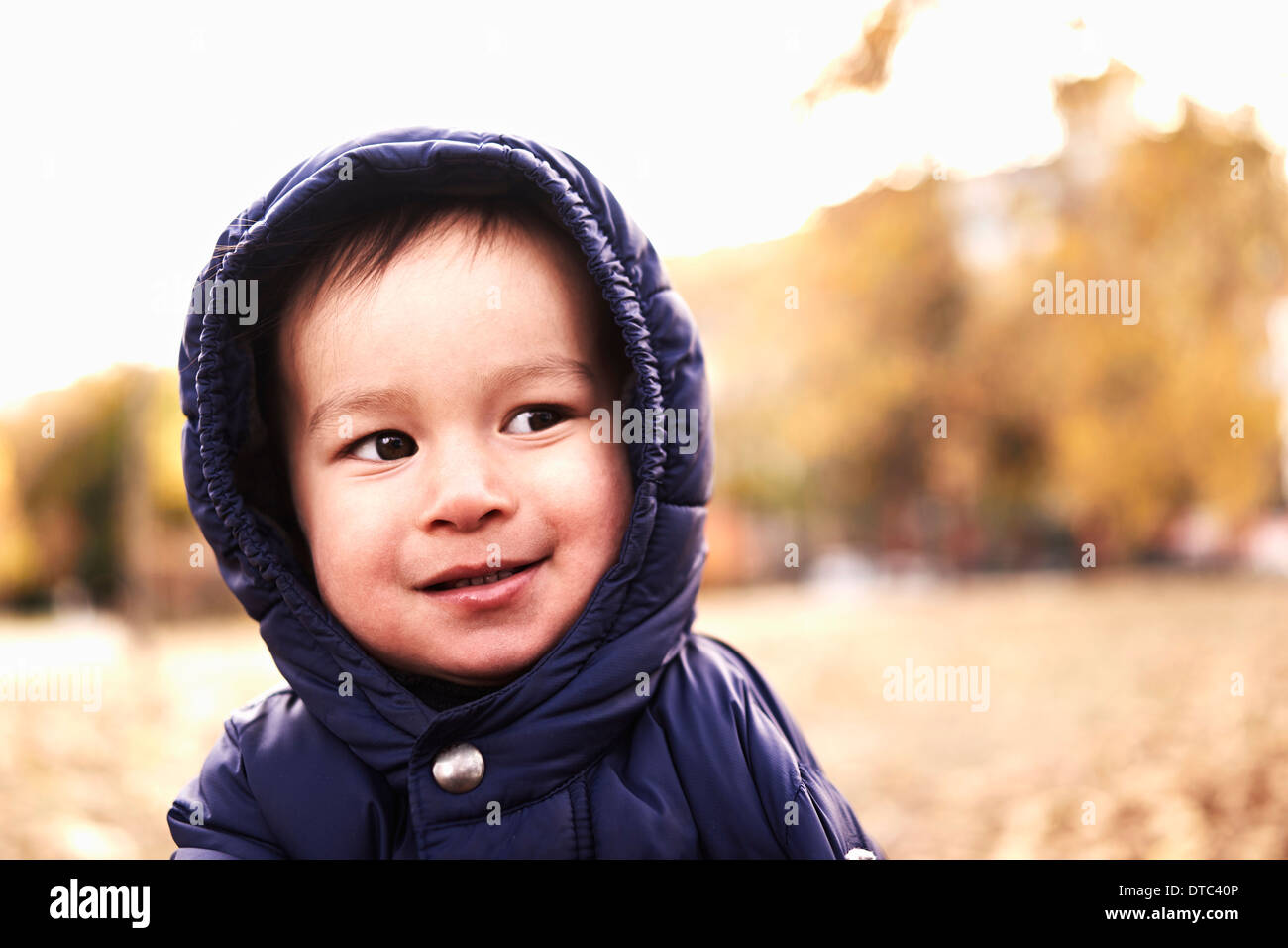 Portrait of baby boy in hooded anorak - Stock Image