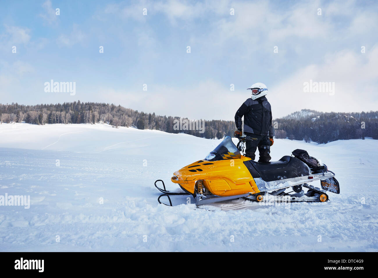 Mid adult man on snowmobile, Togwotee Pass, Wyoming, USA - Stock Image