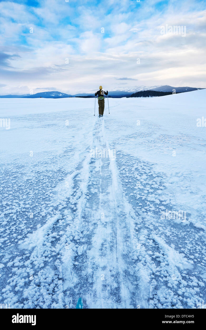 Mid adult woman skiing across vast landscape, Colter Bay, Wyoming, USA - Stock Image