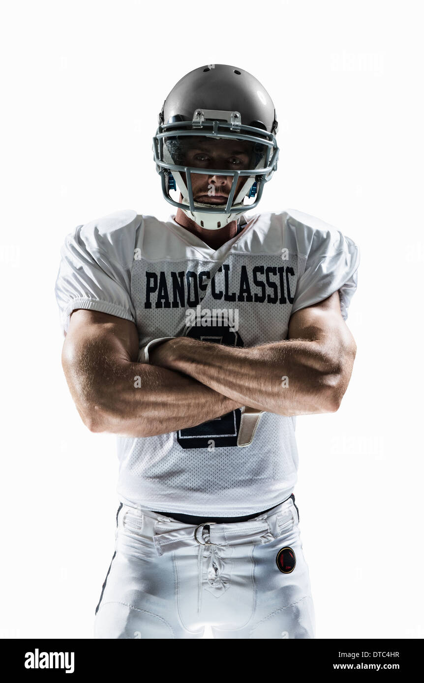 Studio portrait of american football player - Stock Image