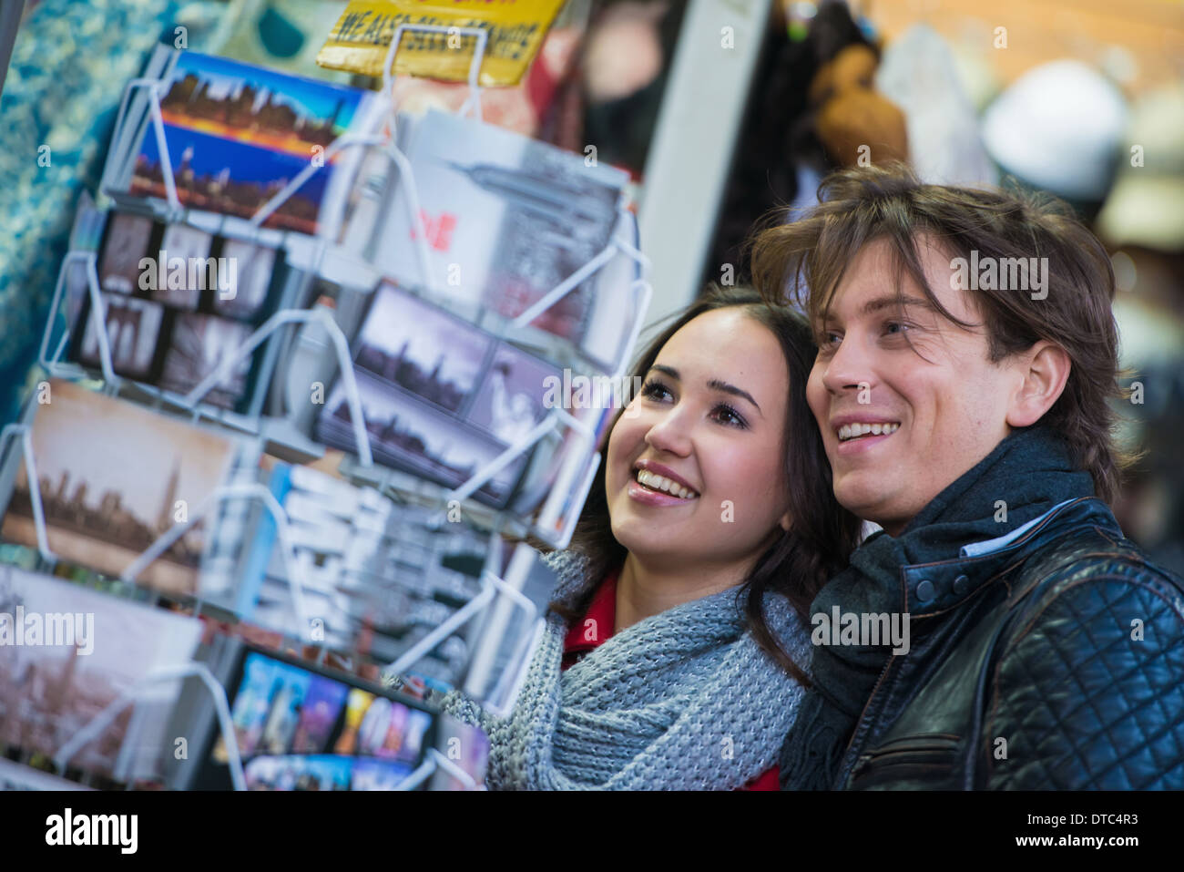 Young tourist couple looking at postcards, New York City, USA - Stock Image
