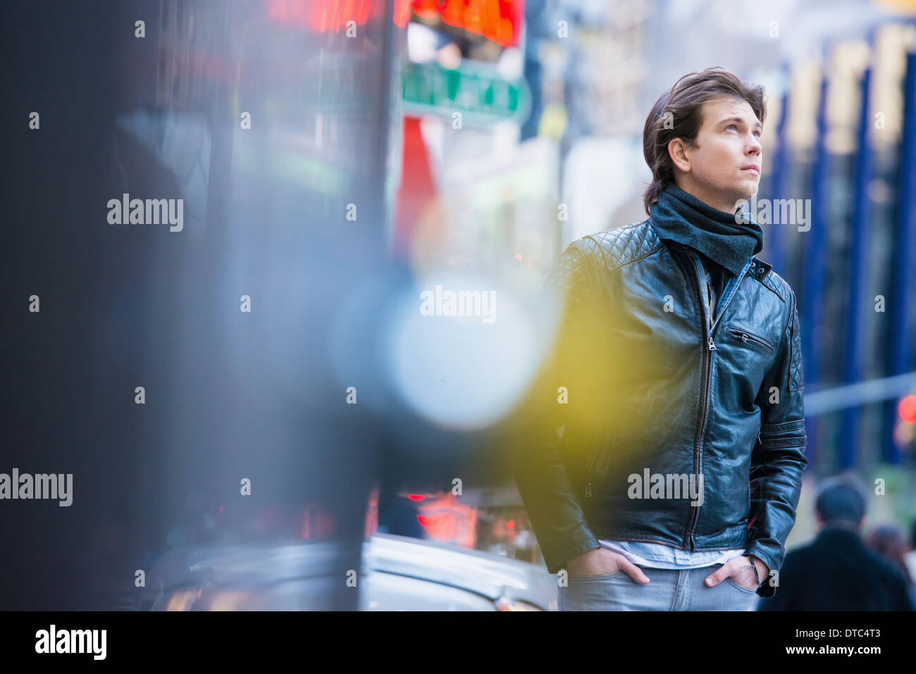 Young male tourist exploring streets, New York City, USA - Stock Image