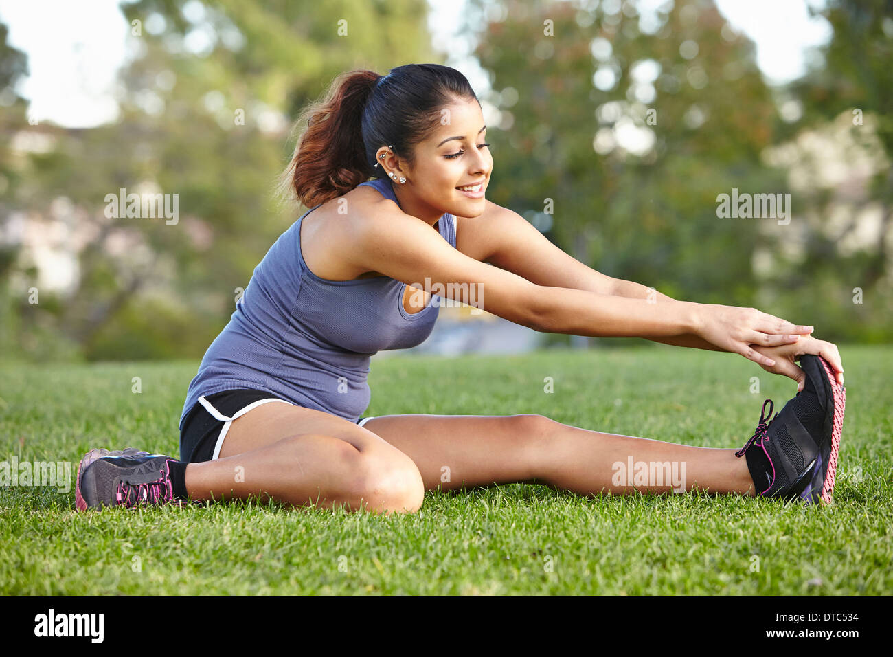 Young woman doing stretching exercise - Stock Image