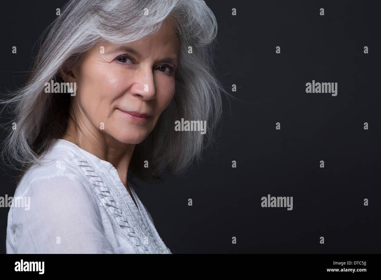 Studio portrait of beautiful senior woman Stock Photo