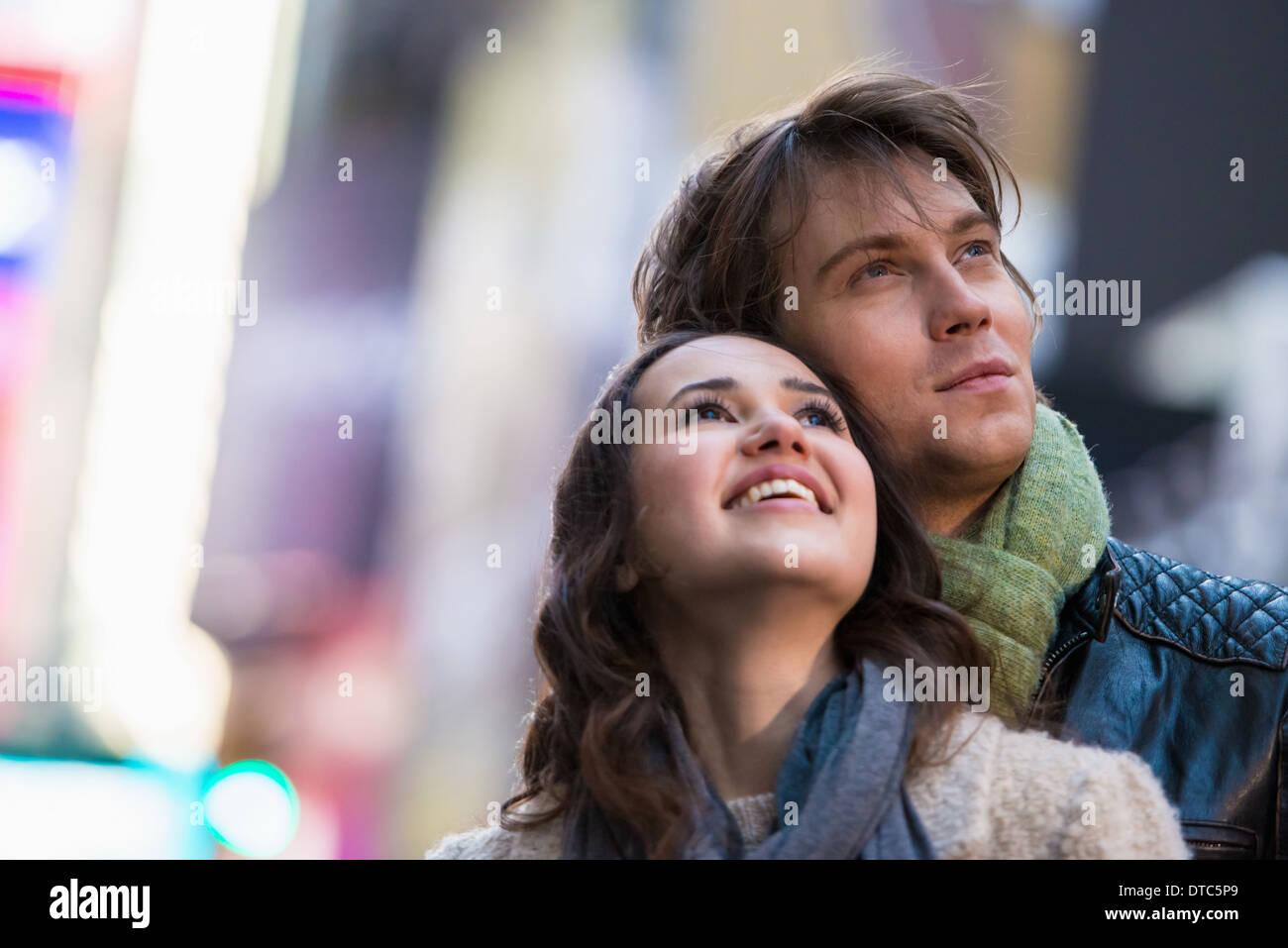 Young couple on vacation looking up, New York City, USA - Stock Image