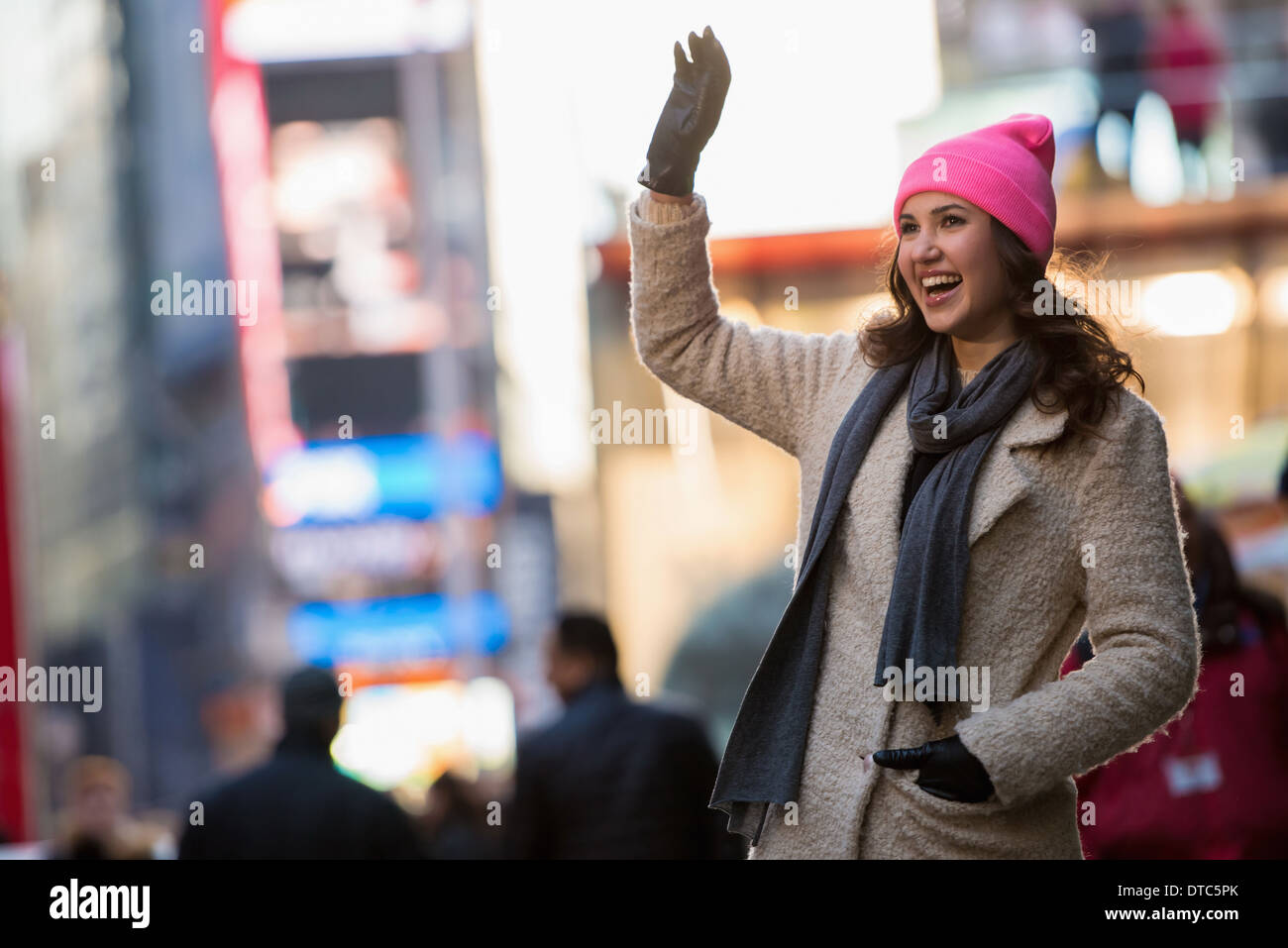 Young female tourist waving from street, New York City, USA - Stock Image