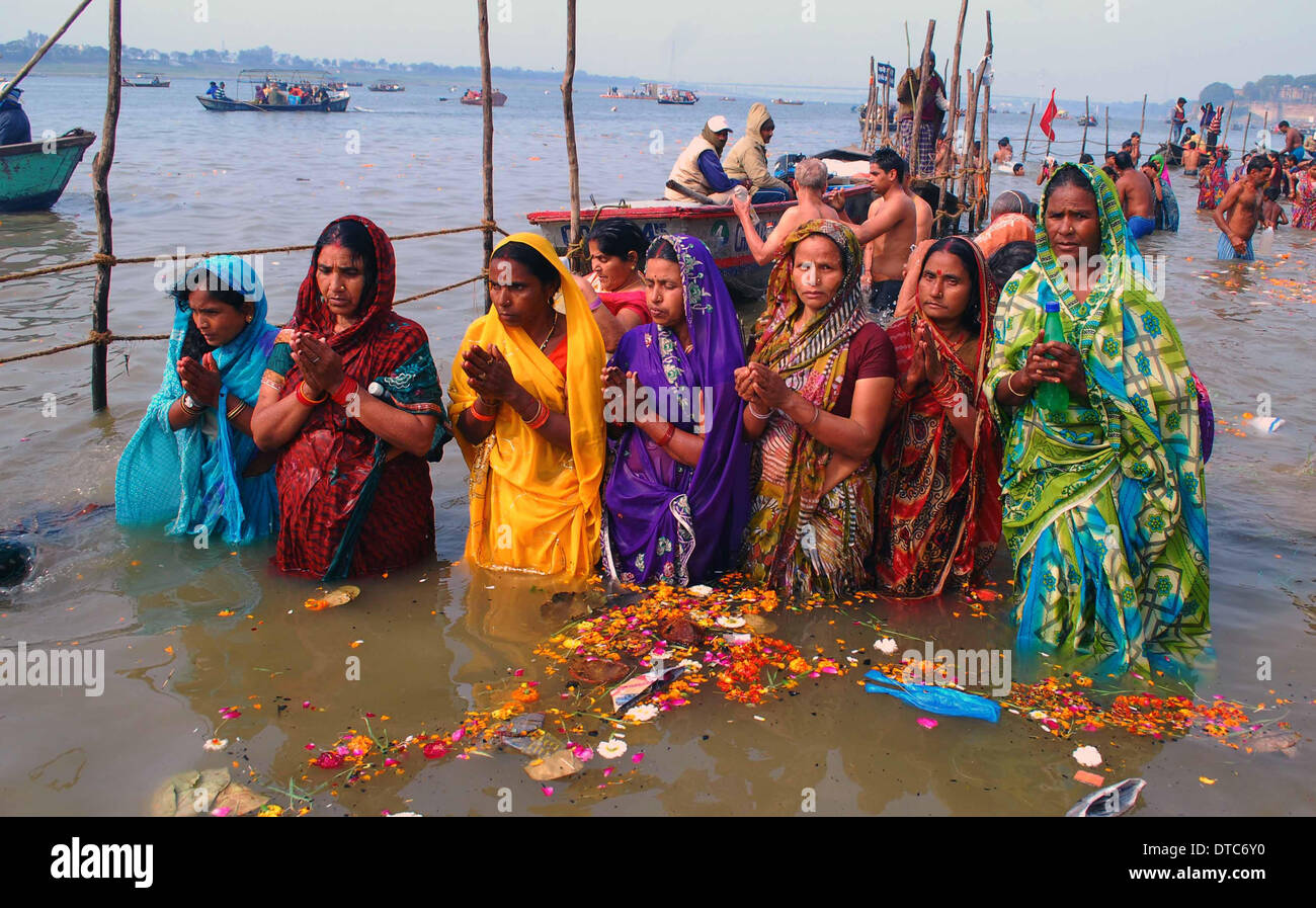 Allahabad, India. 14th Feb, 2014. 14feb.2014: Devotee performing ritual during taking holydip at Sangam on the occasion Stock Photo