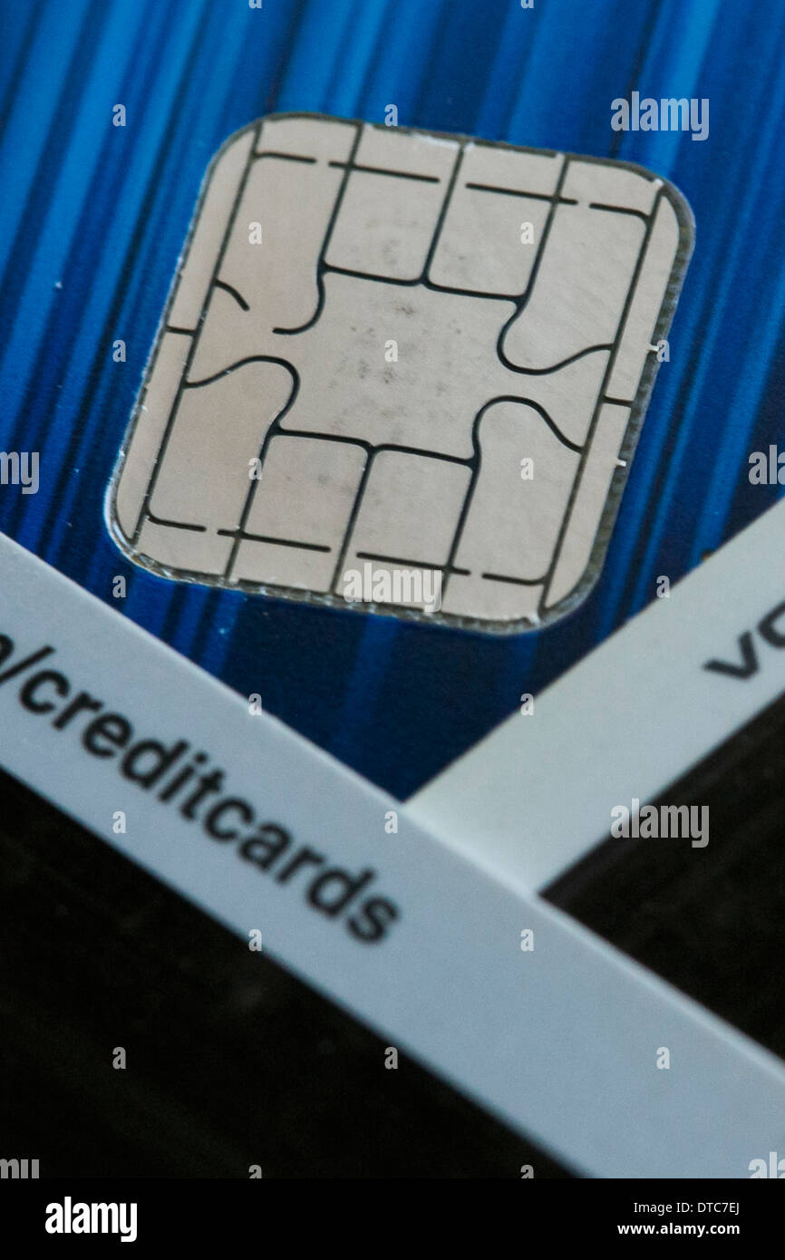 A Visa credit card featuring an EMV chip, also known as 'chip and PIN' juxtaposed with a magnetic strip card. - Stock Image