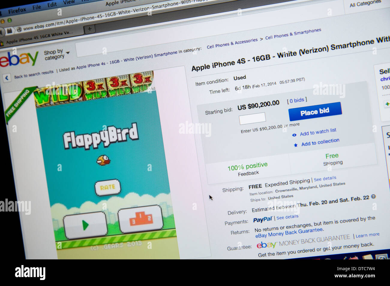 A used iPhone loaded with the FlappyBird app listed on eBay