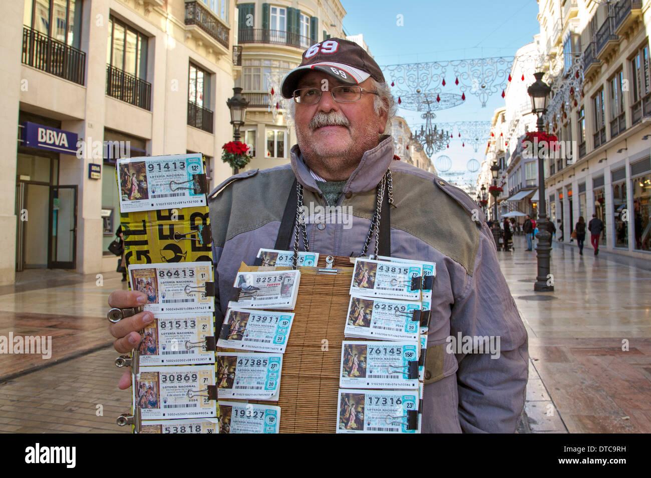 Lottery vendor selling Christmas lottery Calle Larios Malaga Andalusia Spain lotero loteria de navidad andalucia españa - Stock Image