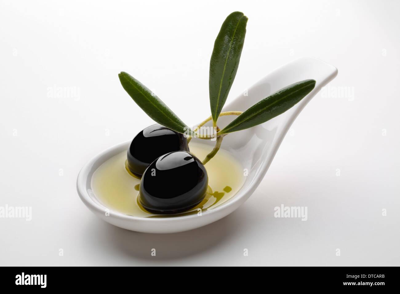 Black olives olive oil aceituna negra en aceite de oliva virgen extra - Stock Image
