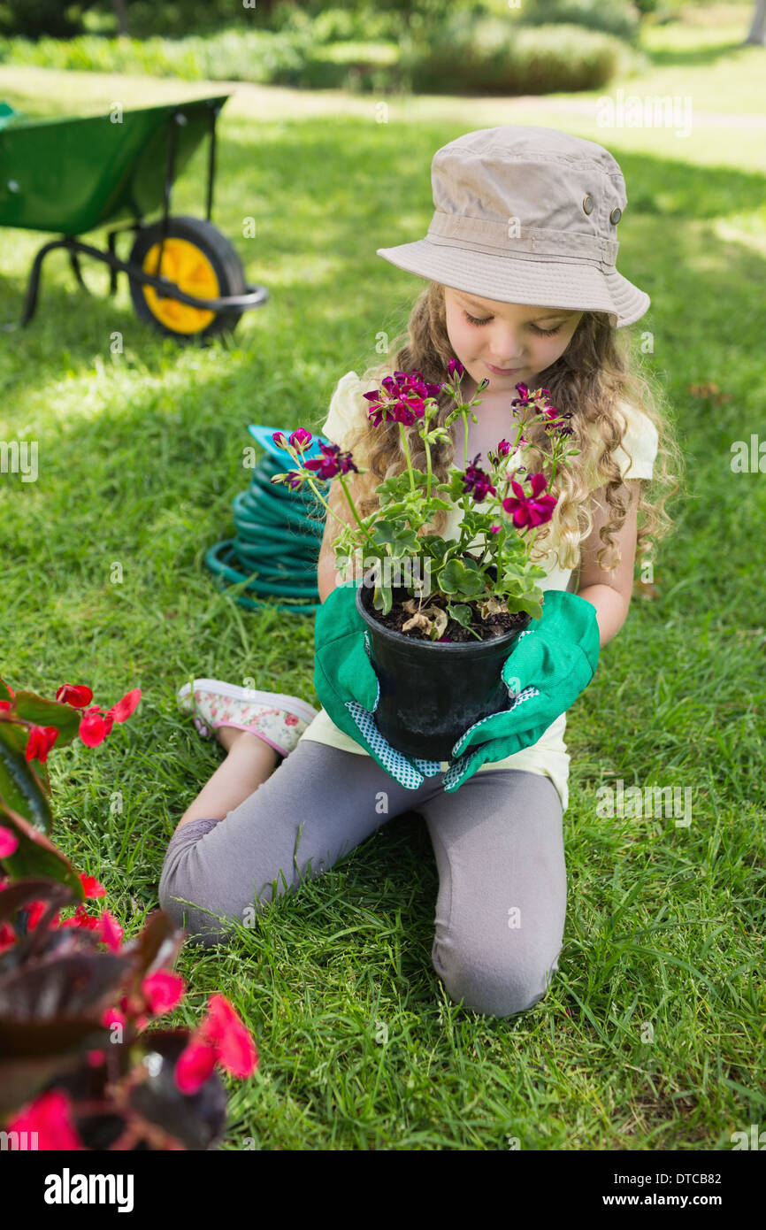 Little girl engaged in gardening - Stock Image