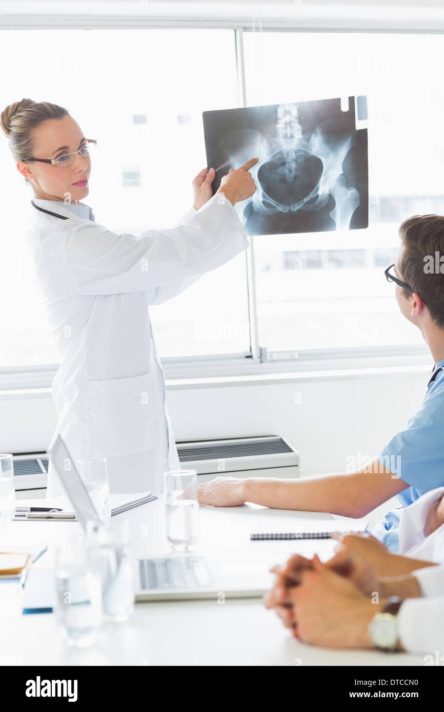 Professional doctor showing Xray to colleagues - Stock Image
