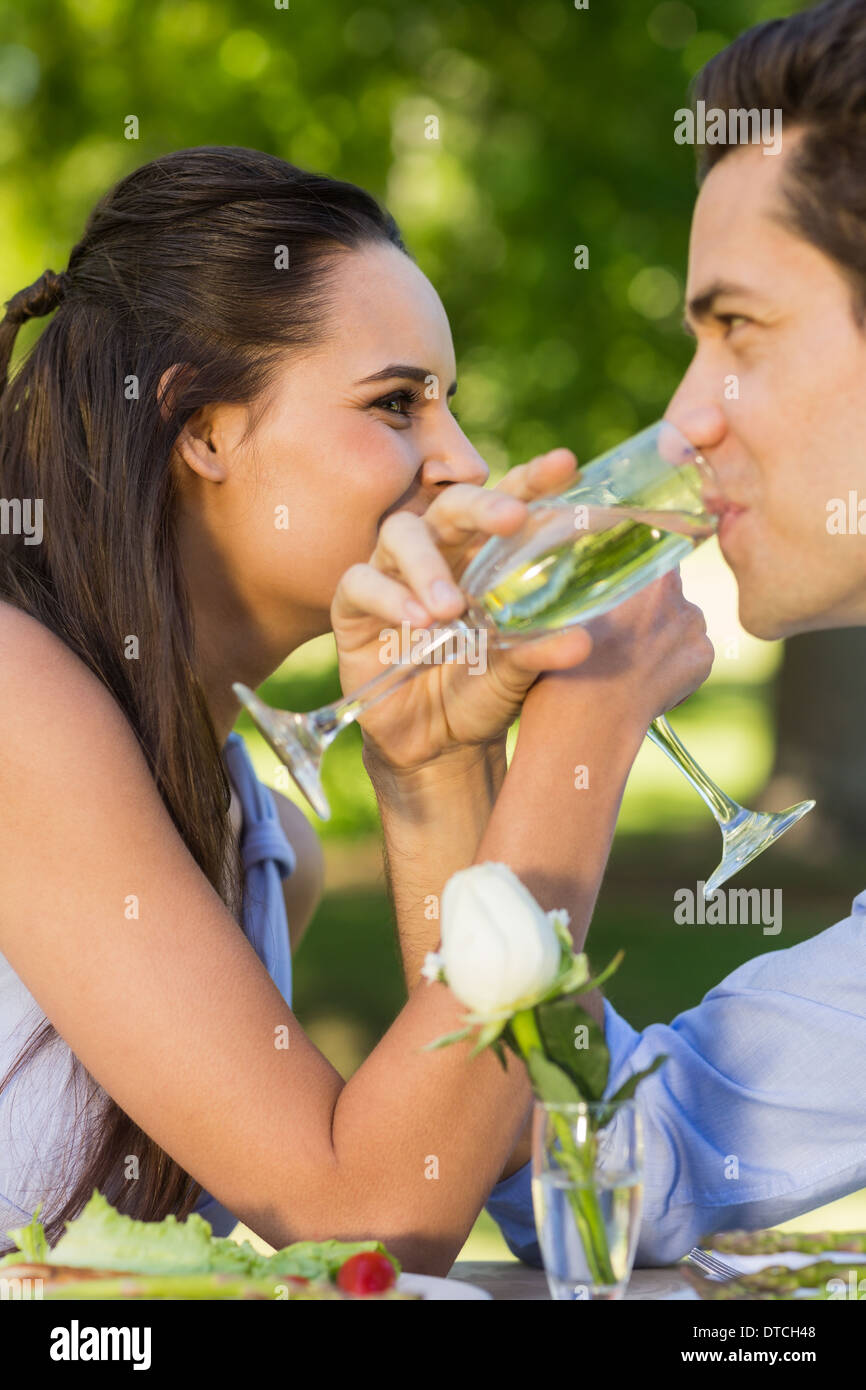 Couple drinking champagne at outdoor café Stock Photo