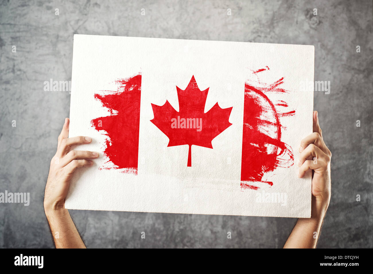canada flag man holding banner with canadian flag supporting stock