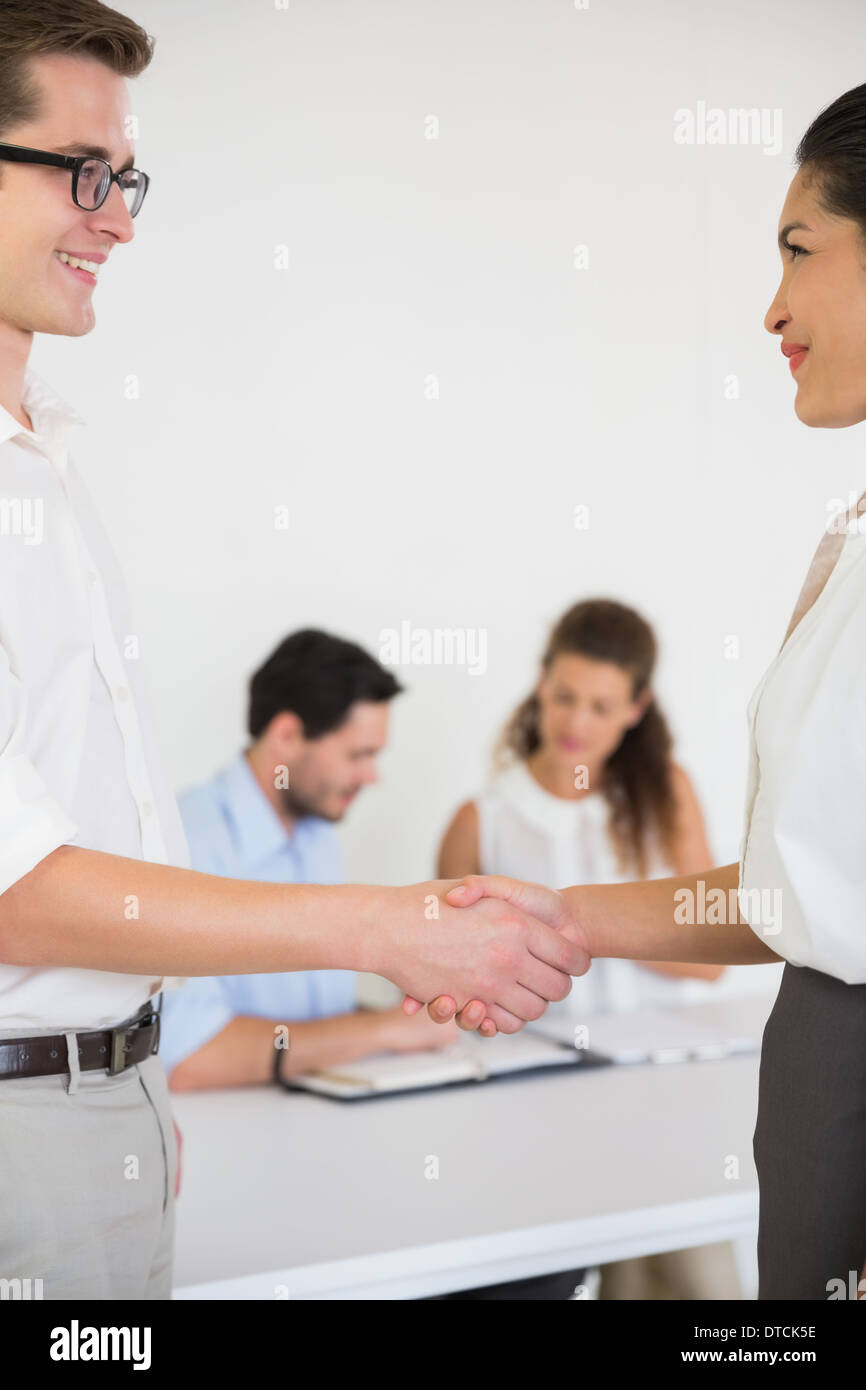 Business people greeting each other - Stock Image