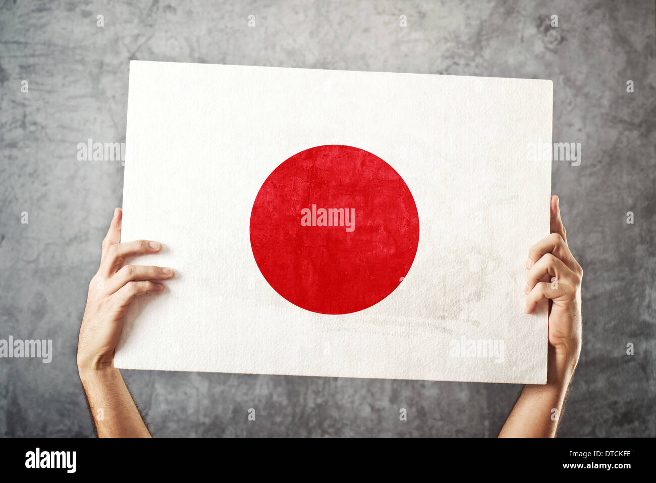Japan flag. Man holding banner with Japanese Flag. Supporting national team, patriotism concept. Stock Photo