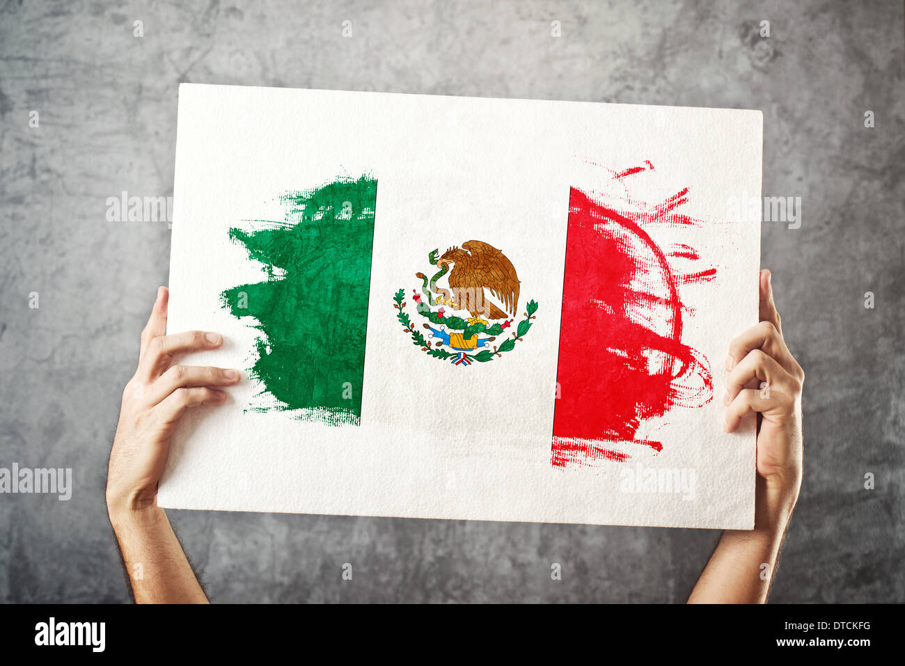Mexico flag. Man holding banner with Mexican Flag. Supporting national team, patriotism concept. - Stock Image
