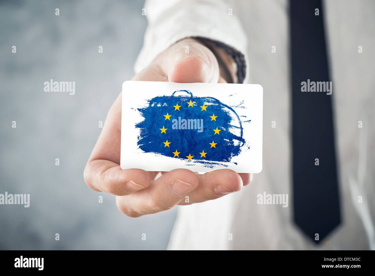 European Businessman holding business card with European union Flag. International cooperation, investments. - Stock Image