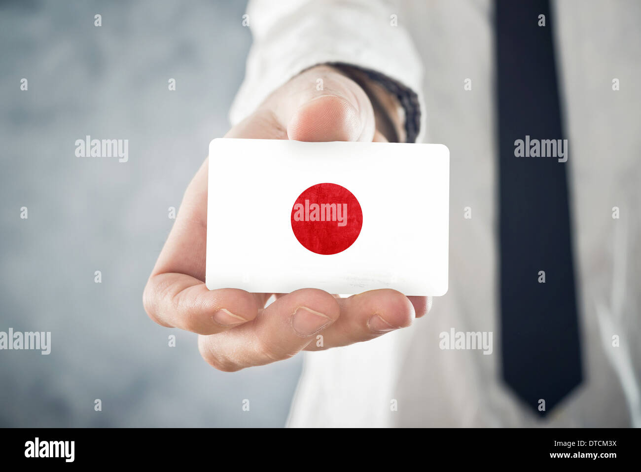 japanese businessman holding business card with japan flag international cooperation investments business opportunities - Japanese Business Card