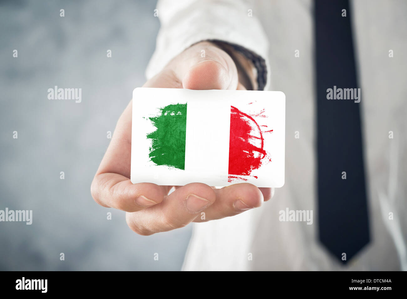 Italian businessman holding business card with italy flag stock italian businessman holding business card with italy flag international cooperation investments business opportunities colourmoves