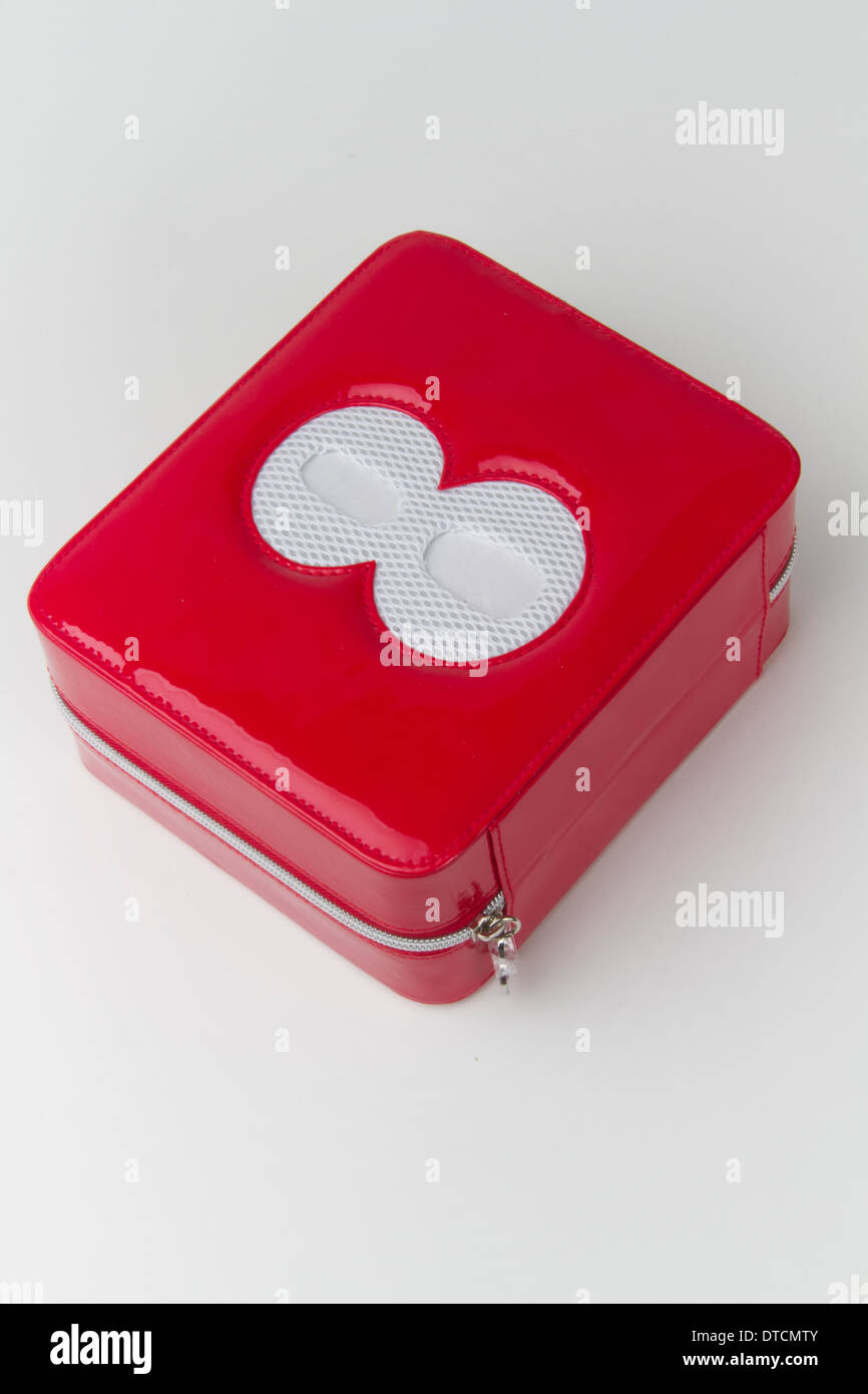 Red plastic zipped make up box with the figure eight etched in its lid - Stock Image