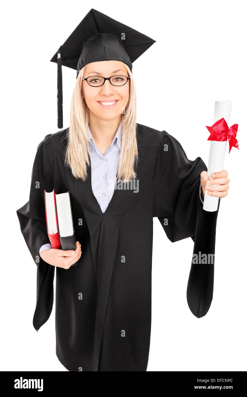Woman in graduation gown holding diploma and books - Stock Image