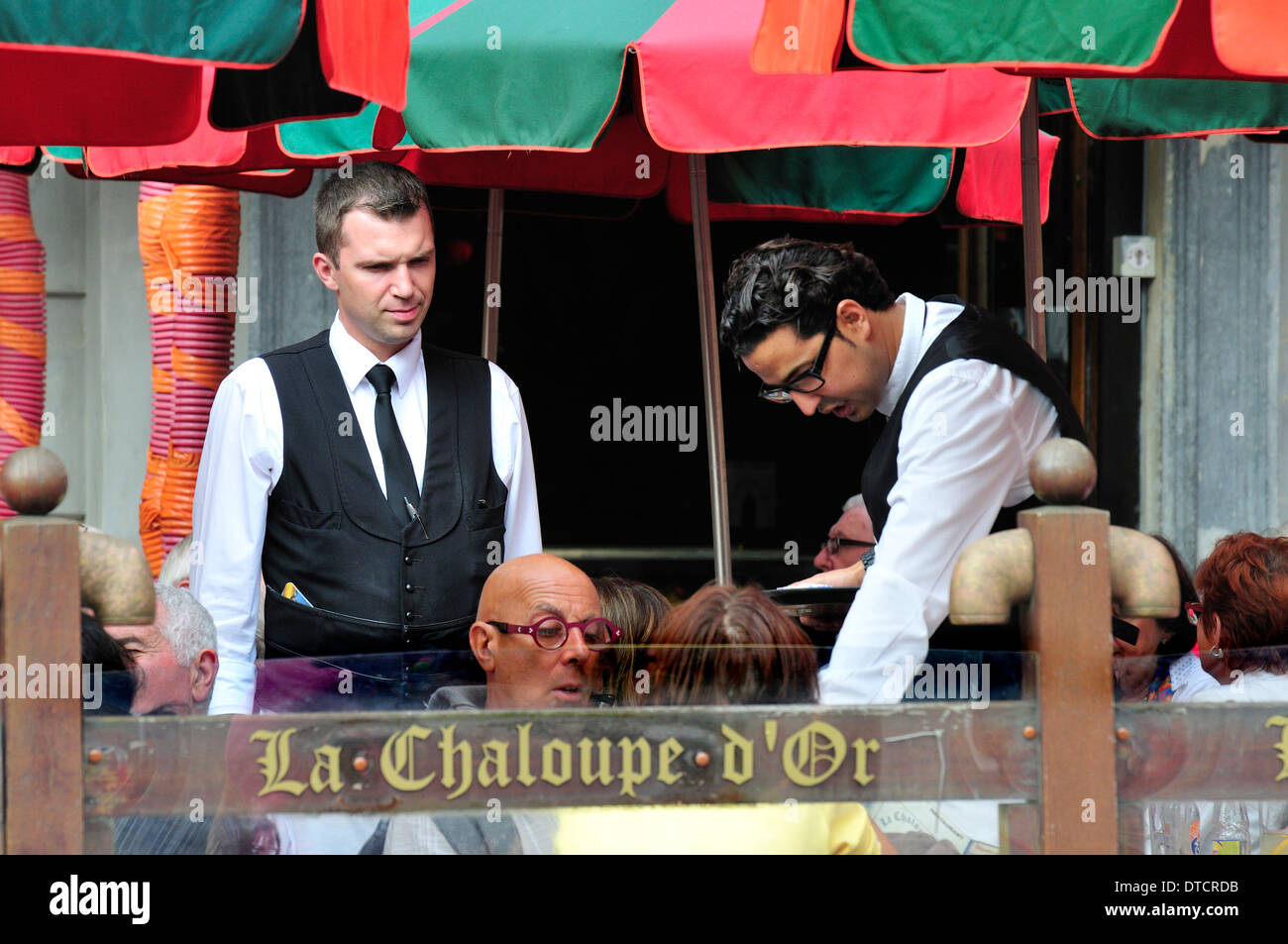 Brussels, Belgium. Waiters at cafe in the Grand Place - Stock Image